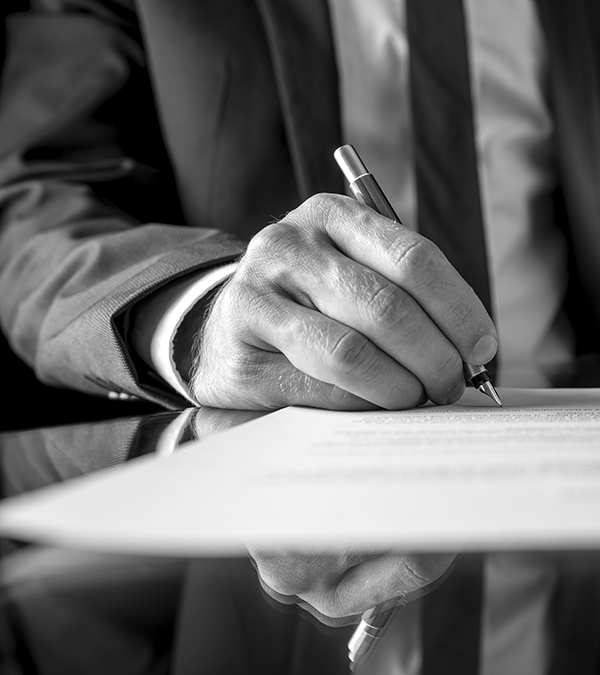 Businessman signing a document or contract